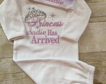 The Princess has arrived personalized newborn gown and hat set.  Perfect for hospital or coming home outfit
