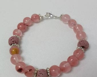 Essential Oil Diffuser Bracelet of Rose quartz with silver accents and Rose Lava Rocks
