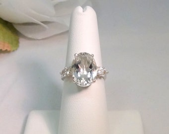 Incredible White Topaz with Accents!  Sterling Silver Ring, Large 14x10mm Oval, Faceted, 4 x 3mm White Topaz Accents.