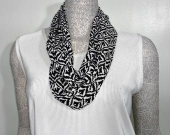 Lightweight black and white abstract print infinity scarf. Rayon fabric dDrapes beautifully.  Machine serged for durabliity and washable.