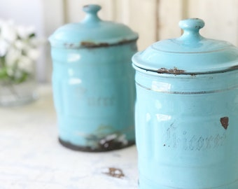 A pair of beautiful pale turquoise 1940's French lidded canisters in weathered and worn condition