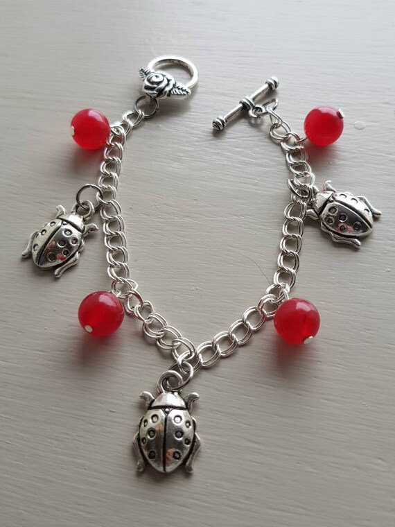 Ladybird bracelet with red jade beads