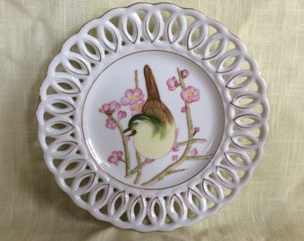 Delicate ceramic wall hanging plate with bird and oriental apple blossom flowers wall decor