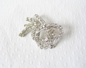 Bombshell: large 1960s high luxe sparkly rhinestone costume pin brooch