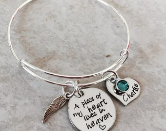 A piece of my heart lives in Heaven personalized bangle bracelet with various options available.