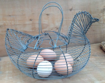 Egg basket in the shape of a hen made of iron threads