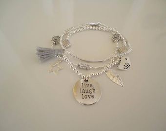 Silvery multi-rows bracelet with a pompom and charms - Gypsy chic jewelry - Bohemian style