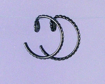 Black KISS2: Tiny textured black niobium earrings