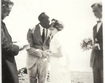 Old Photo Wedding Couple Kiss Officiant Groomsman holding Flower Bouquet 1920s Photograph Snapshot vintage