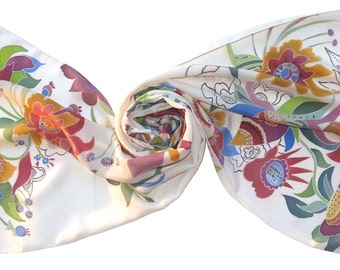 Silk scarf in folk art style with floral motifs on white silk. Hand painted silk scarf, decorative paintings. Soft silk scarf