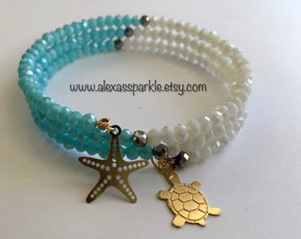 White and Blue Memory Bracelet with Starfish & Turtle Charms/ Pulsera Memoria Blanca y Blue con dijes Estrella de Mar y Tortuga