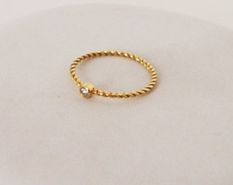 Twisted ring 750 gold & diamond 0.05 Cts