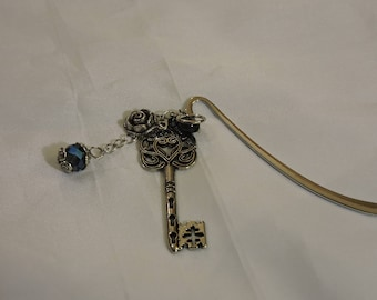 Antique silver key and blue bead bookmark