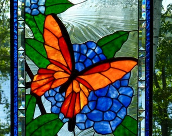 Colorful butterfly on blue hydrangeas -  stained glass panel.