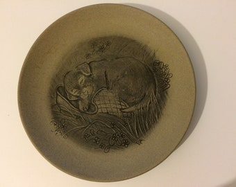 13cm Poole pottery plate puppy sleeping on a slipper by Barbara Linley Adams Good condition. 13 cm stoneware.
