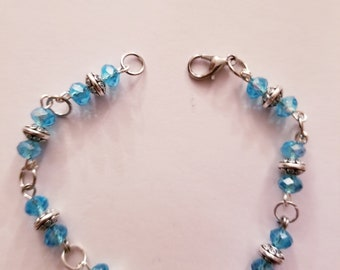 Light blue and flat silver beaded bracelet
