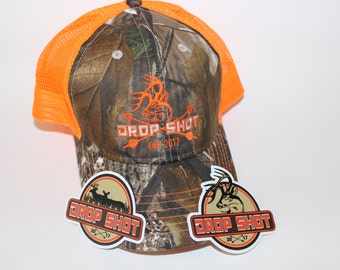orange and camo hunting cap stiched deer and crossing arrows