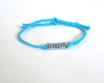 Turquoise blue braided bracelet small metal nuts Brasilda