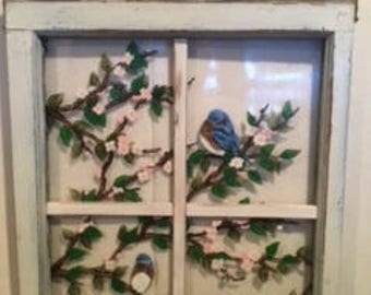 Hand painted re-purposed window of blue birds sitting in branches of cherry blossoms