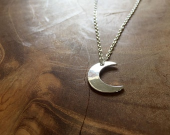 Moon - a cute necklace with a little crescent moon. Silvertone, cute, modern, hip, trend, trendy, moon, star, night, sky, hipster