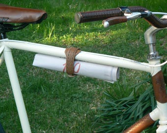 Bicycle multiuse holder, lock umbrella...
