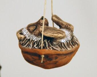 Sleeping Hedge Hog Walnut Ornament