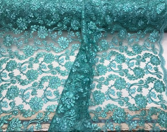 Aqua flowers embroider with sequins ans corded on a mesh lace-wedding-bridal-prom-nightgowns-decorations-sold by the yard.