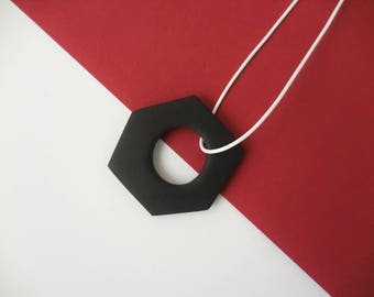 Geometric minimalistic necklace in black and white. Handmade of clay. Special and clean design.