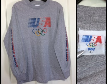 1980s 1984 USA Olympics Los Angeles printed long sleeve t-shirt by Levis size large 18.5x26 soft heather gray athletic sports