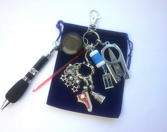 Crafter's Tool Kit - stitch markers, crochet hook, row counter, folding scissors, progress keepers, pen on retractable cord