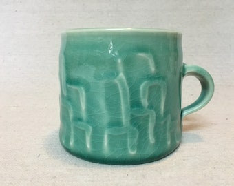 Handmade Mug with Celadon Glaze and Cityscape Design