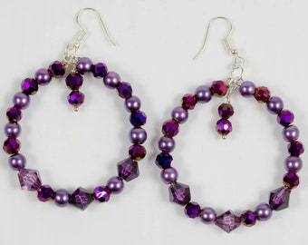 Beautiful purple shimmery earings a real glamour pair .