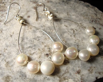 White fresh water pearls on sterling silver earring hoops