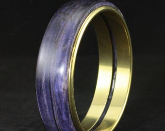 Wood Bracelet made from purple dyed and stabilized maple burl with brass colored metal sleeve.