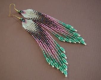 wild lily long seed bead fringe earrings! statement earrings in crystal clear, dark red, pink & green. petal inspired w/leafy fringes