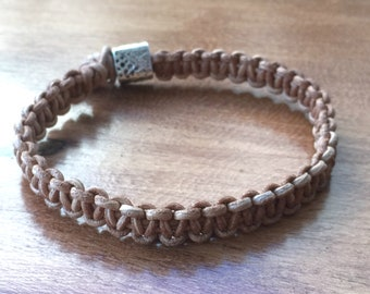 Braided leather bracelet with silver-colored piece