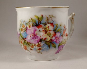 Floral design Porcelain Tea Cup, approx 3.5 inches high