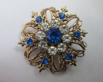 Vintage Jewelry  Blue rhinestone with antiqued gold tone metal Brooch no markings
