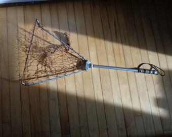vintage fold up fishing net made of aluminum and bakelite.