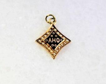 "Seed Pearl 10k Gold ""AHO"" Charm"
