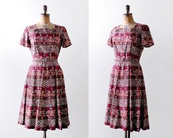 50's red batik print dress. 1950's m dress. pleated. red, orange, white.