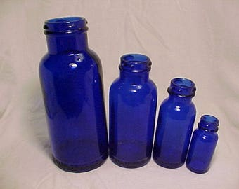 Set of Four c1930s Bromo Seltzer Emerson Drug Co. Baltimore, MD., Cobalt Blue Twist Top Bottles