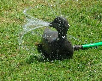 Vintage, rare, and adorable WORKING metal duck water sprinkler
