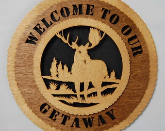 """Laser cut   """"Welcome To Our Getaway""""  wall plaque.  Let this moose welcome visitors to your home or cottage!"""