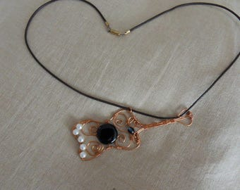 copper wire and leather cord pendant