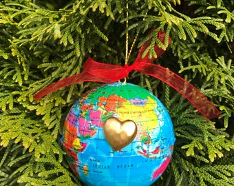 Globe Ornaments with gold heart marking location