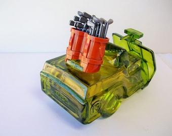 Avon Green Glass Golf Cart Bottle         Free shipping in USA