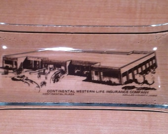 Vintage collectible rectangular glass tray from Continental Western Life Insurance Company in Dallas County, Iowa. Has an interesting illust
