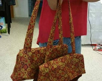 Designed, Handled, and made with love.  Purses, bags, totes, doll clothes, tween girl clothing, teen girl clothing.