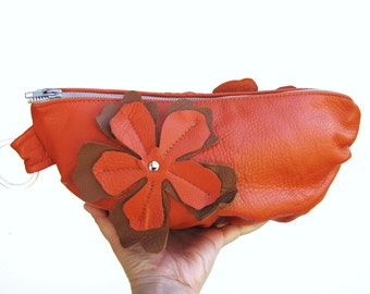 Orange leather clutch, Leather Wristlet, leather cosmetic bag with Flower Applique